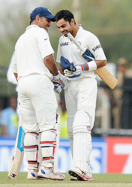 MS Dhoni captain of India congratulates teammate Virat Kohli of India as the latter scores a century