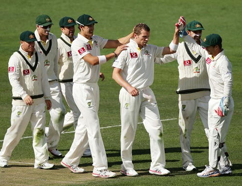 Peter Siddle (centre) of Australia celebrates with teammates