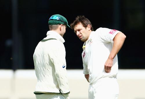 Australian captain Michael Clarke talks with bowler Ben Hilfenhaus