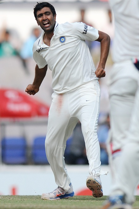 Ravichandran Ashwin of India celebrates the wicket of Alastair Cook