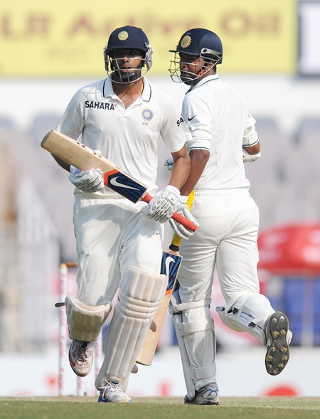 Ravichandran Ashwin of India and Pragyan Ojha