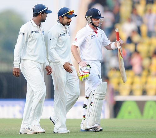 Pragyan Ojha, Virat Kohli of India and Ian Bell of England walk back at the end of days play