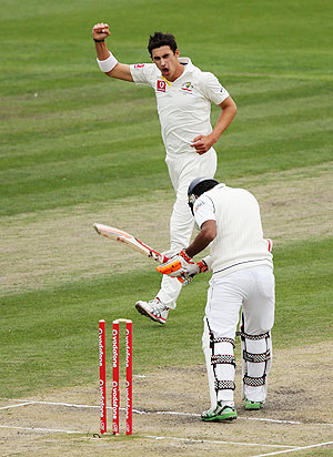 Australia'S Mitchell Starc celebrates after dismissing Sri Lanka's Dimuth Karunaratne on day four of the First Test on Monday
