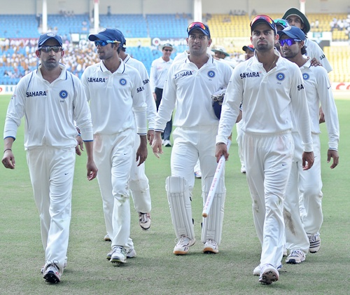 Team India walks back after the days play