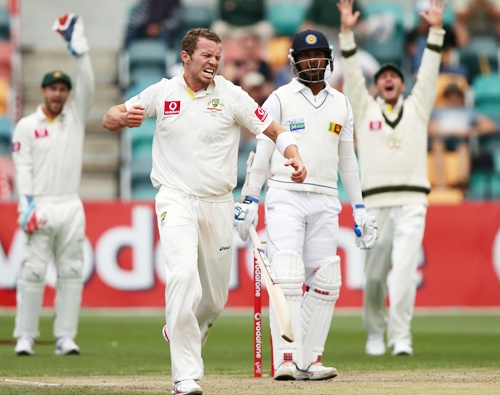 Peter Siddle of Australia celebrates