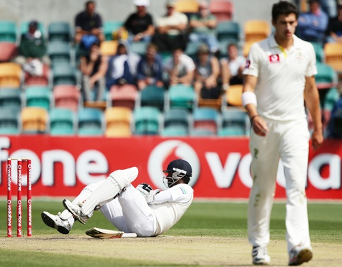 Angelo Mathews of Sri Lanka lies down after being hit by a ball from Mitchell Starc