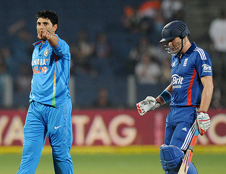 Yuvraj Singh celebrates after claiming the wicket of Luke Wright