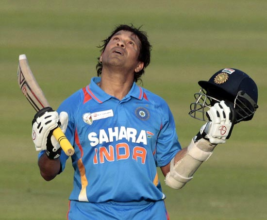 Sachin Tendulkar celebrates after he scored his 100th international century during their Asia Cup ODI match against Bangladesh in Dhaka