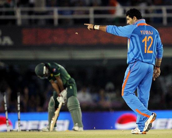 Yuvraj Singh celebrates a wicket