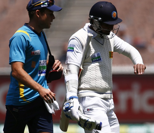 Sri Lanka's Kumar Sangakkara (right) looks at his injured finger