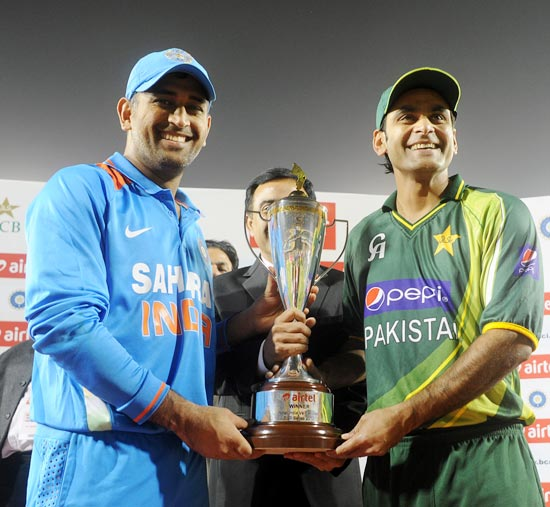 Mahendra Singh Dhoni and Mohammad Hafeez with the series trophy at the end of the match. The two-match series ended in a 1-1 draw