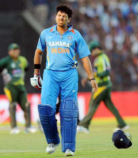 Yuvraj Singh hit by a Mohammad Irfan yorker