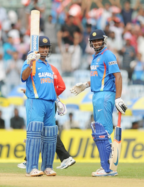 Dhoni happy being a 'punching bag'