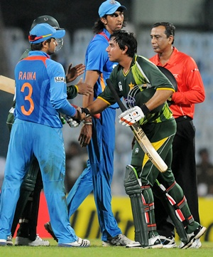 Nasir Jamshed of Pakistan is congratulated by Suresh Raina