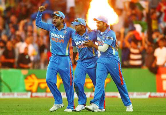 Suresh Raina of India is congratulated by tem mates after catching David Warner of Australia during the International Twenty20 match between Australia and India