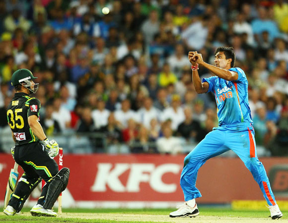 Rahul Sharma of India drops a caught and bowled chance during the International Twenty20 match between Australia and India at ANZ Stadium