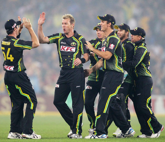 Brett Lee celebrates with teammates after taking the wicket of Virender Sehwag during the 1st Twenty20 on Wednesday