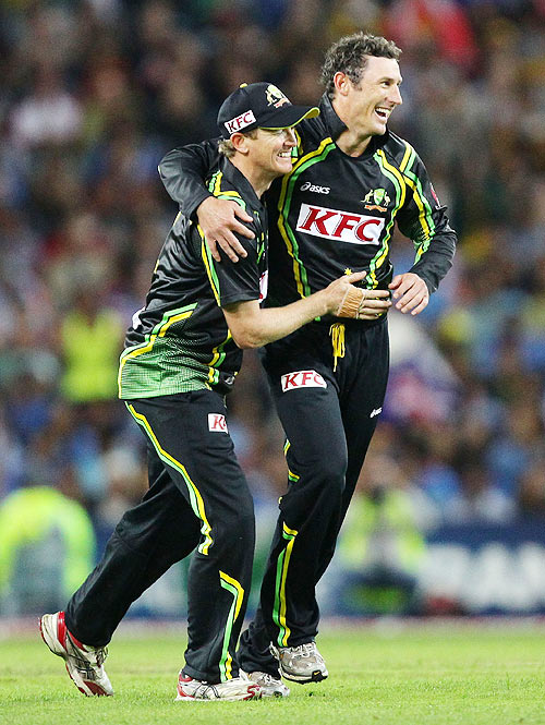 David Hussey (right) celebrates with captain George Bailey after taking the wicket of Gautam Gambhir on Wednesday