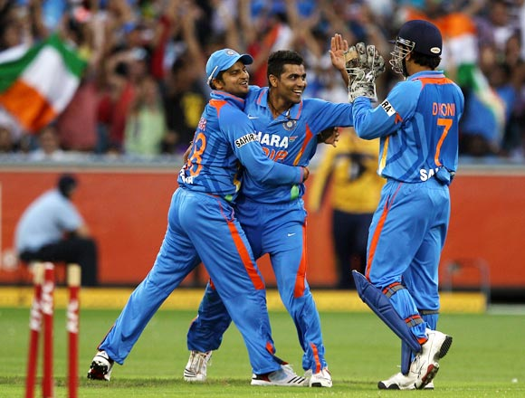 The Indian players celebrate the run out of George Bailey