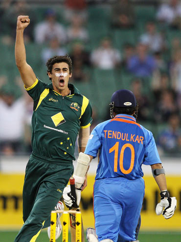Mitchell Starc of Australia celebrates the wicket of Sachin Tendulkar of India during game one of the Commonwealth Bank tri-series