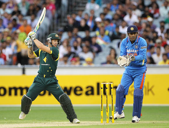 Matthew Wade of Australia cuts with MS Dhoni of India looking on during game one of the Commonwealth Bank tri-series