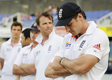 A distraught England captain Andrew Strauss (right) waits with teammates for the presentation ceremony after Pakistan won the third Test match in Dubai on Monday