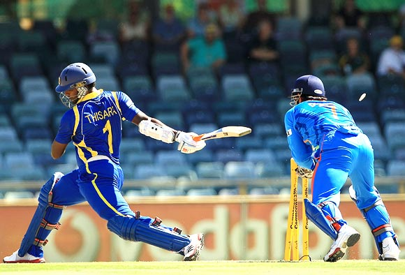 Thisara Perera is stumped by Mahendra Singh Dhoni