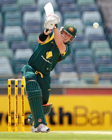 David Warner bats during game three of the tri-series