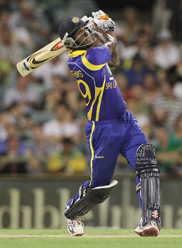 Angelo Mathews goes for a big shot