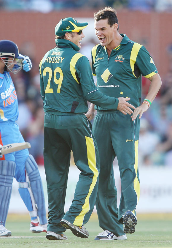David Hussey (left) and Clint McKay (right) of Australia celebrate after McKay got the wicket of Virender Sehwag