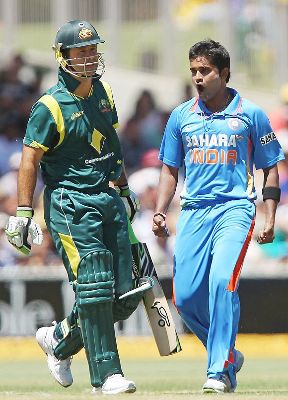 Vinay Kumar (right) of India celebrates after getting the wicket of Ricky Ponting