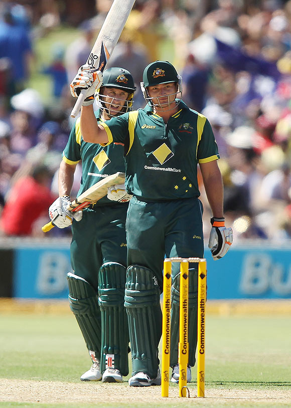 Peter Forrest (right) of Australia celebrates reaching 50 runs along with team-mate David Hussey (left)