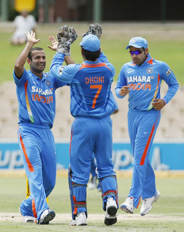 Irfan Pathan (L) of India celebrates the wicket of Tillakaratne Dilshan of Sri Lanka with captain MS Dhoni (C) during their one-day international cricket match in Adelaide