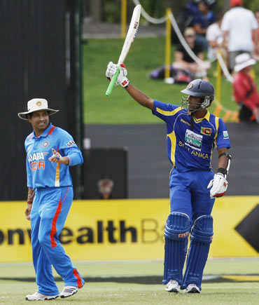 Dinesh Chandimal (R) celebrates after scoring 50 as Sachin Tendulkar looks on