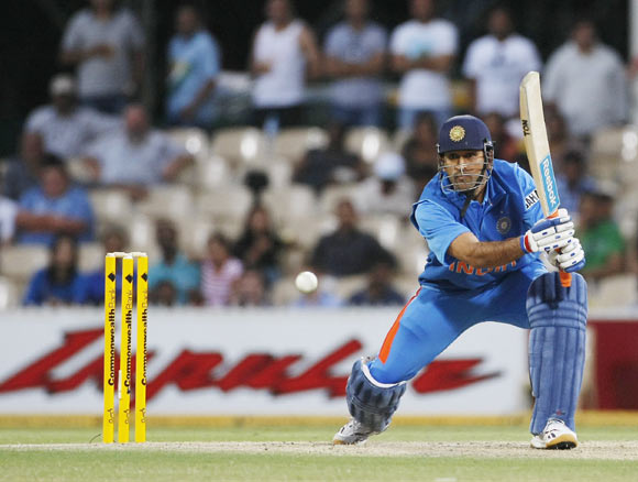 MS Dhoni plays a shot in the crunch overs