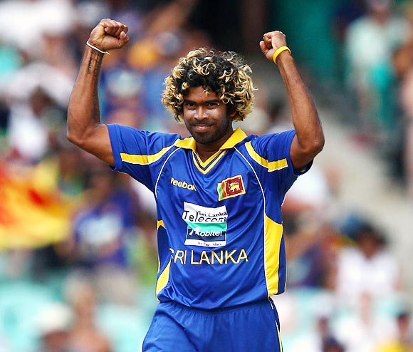 Lasith Malinga celebrates after claiming the wicket of David Warner
