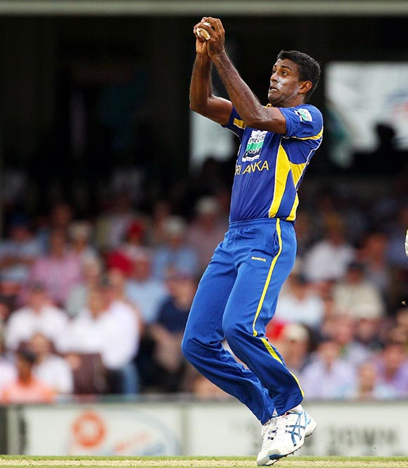 Farveez Maharoof takes a return catch to dismiss Ricky Ponting