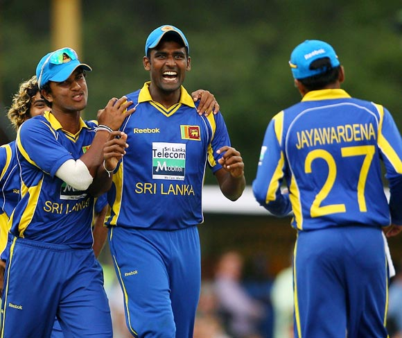 Thisara Perera celebrates after running out Brett Lee
