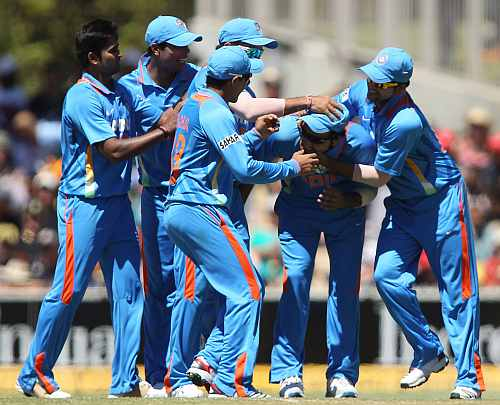 Indian team celebrates after a fall of a wicket
