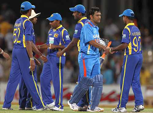 MS Dhoni shakes hands with Sri Lankan players after the