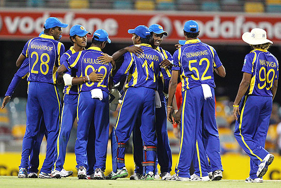 Sri Lankan team celebrates their win over India
