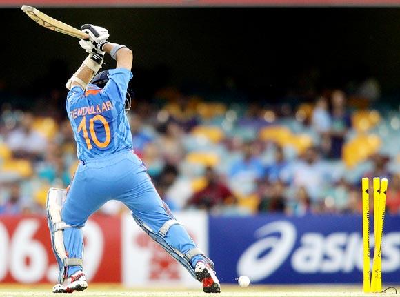Sachin Tendulkar is bowled by Sri Lanka pacer Nuwan Kulasekara