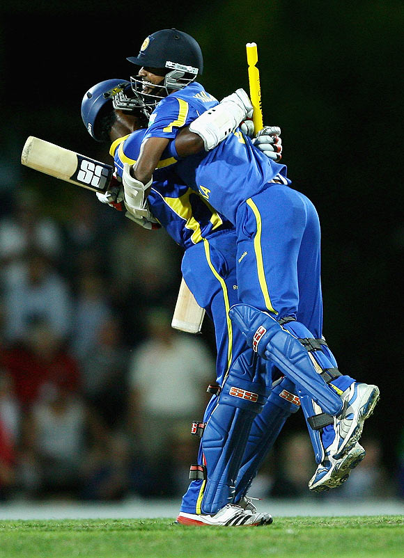 Sri Lanka's Thisara Perera and Nuwan Kulasekara celebrate after scoring the winning runs to beat Australia at Bellerive Oval on Friday