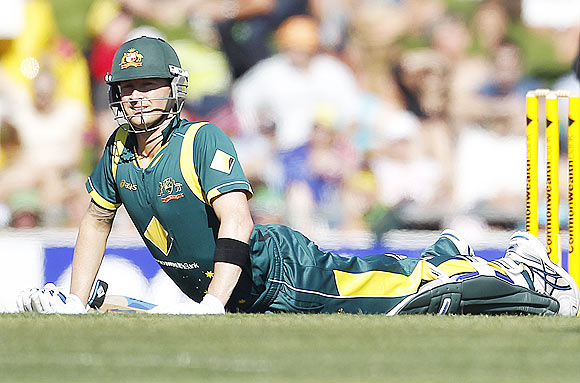 Michael Clarke stretches during the match