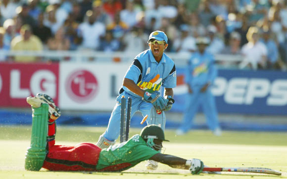 Indian wicketkeeper Rahul Dravid appeals to the Umpire for a run out while Maurice Odumbe of Kenya reaches for the crease during the ICC Cricket World Cup Super Six game