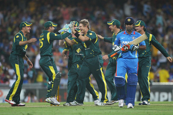 Shane Watson of Australia celebrates dismissing Suresh Raina of India during the One Day International match between Australia and India at the Sydney Cricket Ground