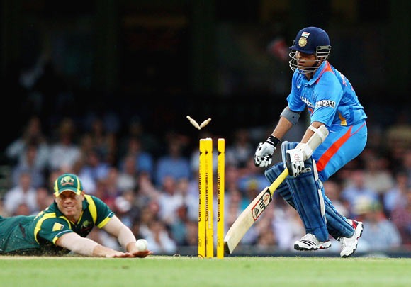 Sachin Tendulkar of India is run out by David Warner of Australia during the One Day International match between Australia and India at Sydney Cricket Ground