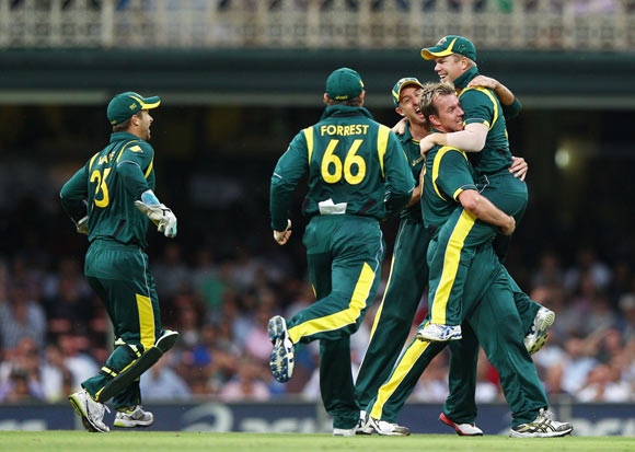 David Warner and Brett Lee of Australia celebrate after Warner ran out Sachin Tendulkar of India during the One Day International match