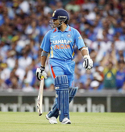 Sachin Tendulkar looks over his shoulder as he walks from the field after being run out by David Warner