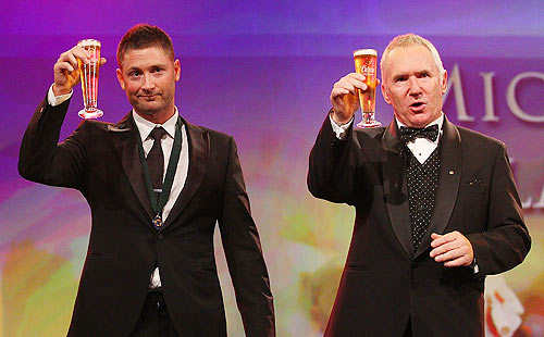 Michael Clarke (left) of Australia shares a toast with Allan Border